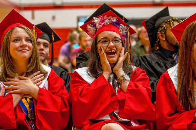 Students in caps and red gowns at Stevens High School graduation.