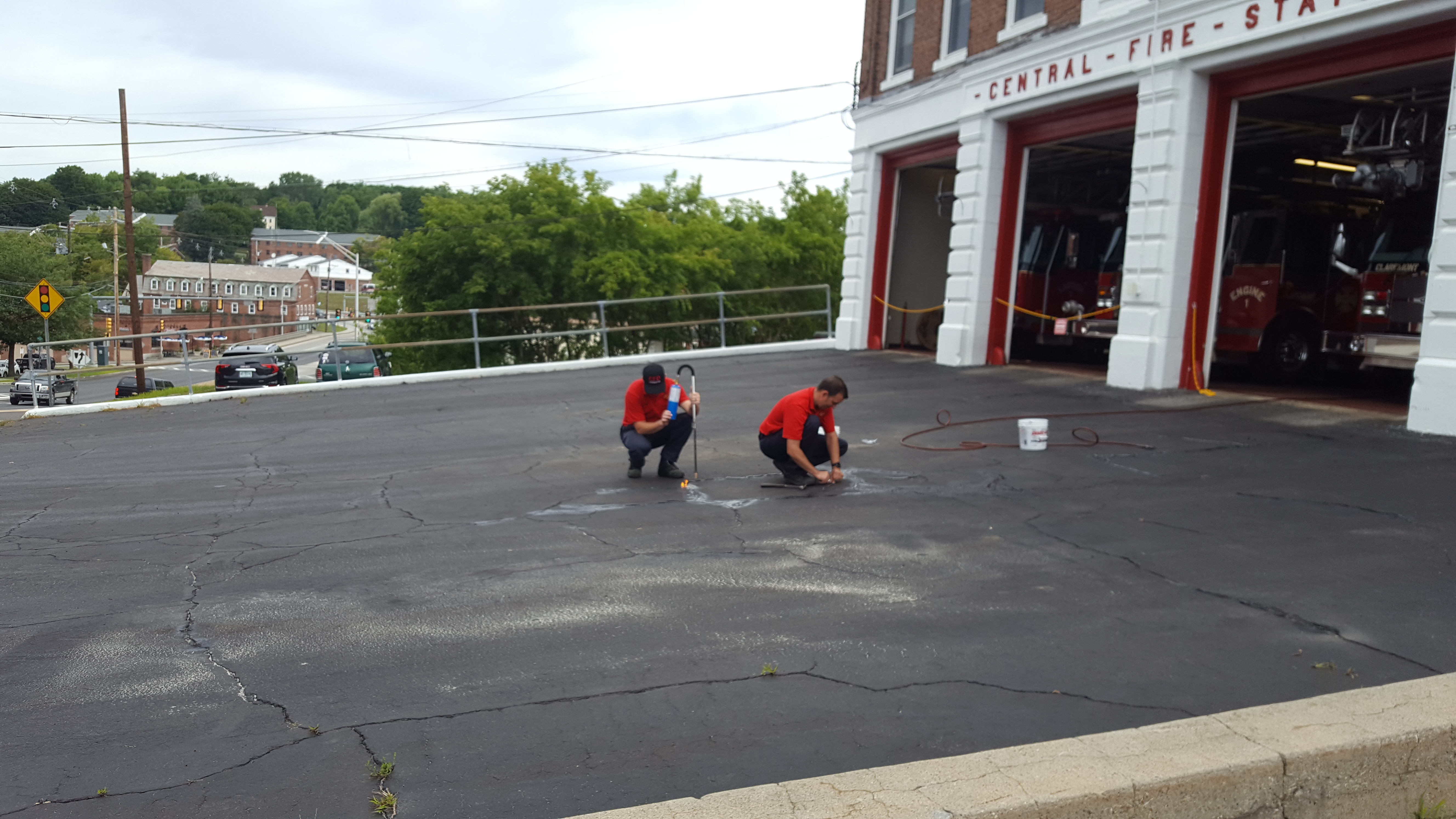 Picture of Fire Fighter making repair to Fire Station Ramp